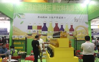 云南原始雨林芒果饮料有限公司在第12届全国食品博览会暨糖酒商品交易会上受追捧!